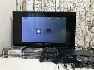 Ps2 console with 3 Controllers, 2 Memory Card, 12 Games for Sale in Denver, CO