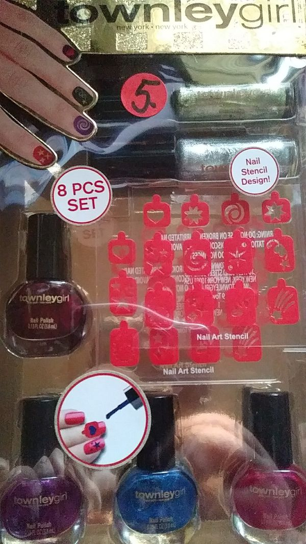 8 piece Townley girl Nail set. 4 Oval nail polishes, 2 nail art ...