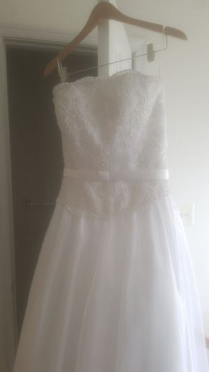 Beautiful, like new, wedding dress size 10. Decorative top. Strapless. Very pretty and modest. for Sale in McLean, VA
