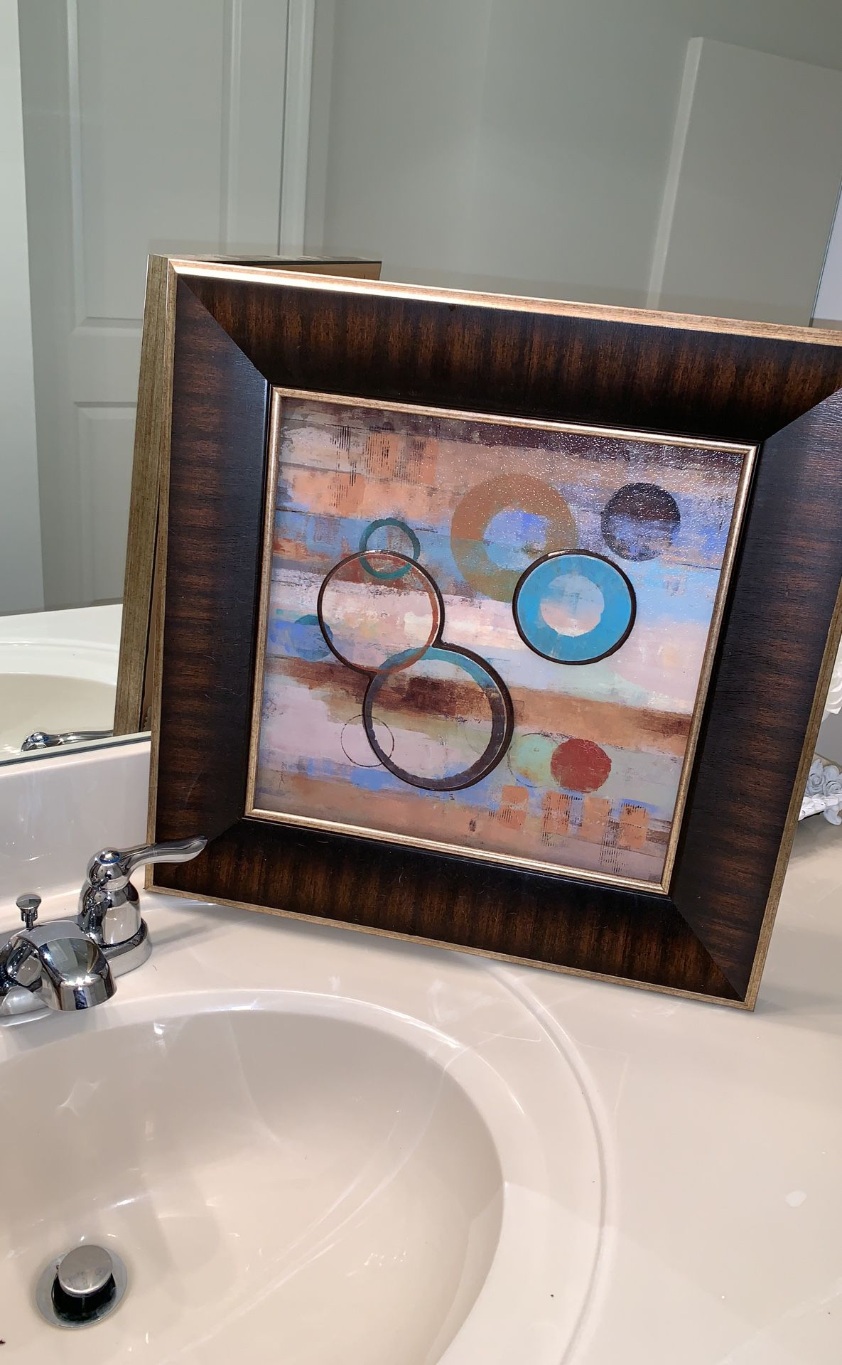 A set of two beautifully framed wall art. 55