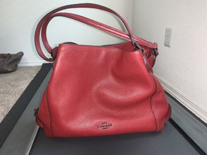 Photo Almost brand new red coach purse, comes with original dust bag. No stains, scratches or odor.