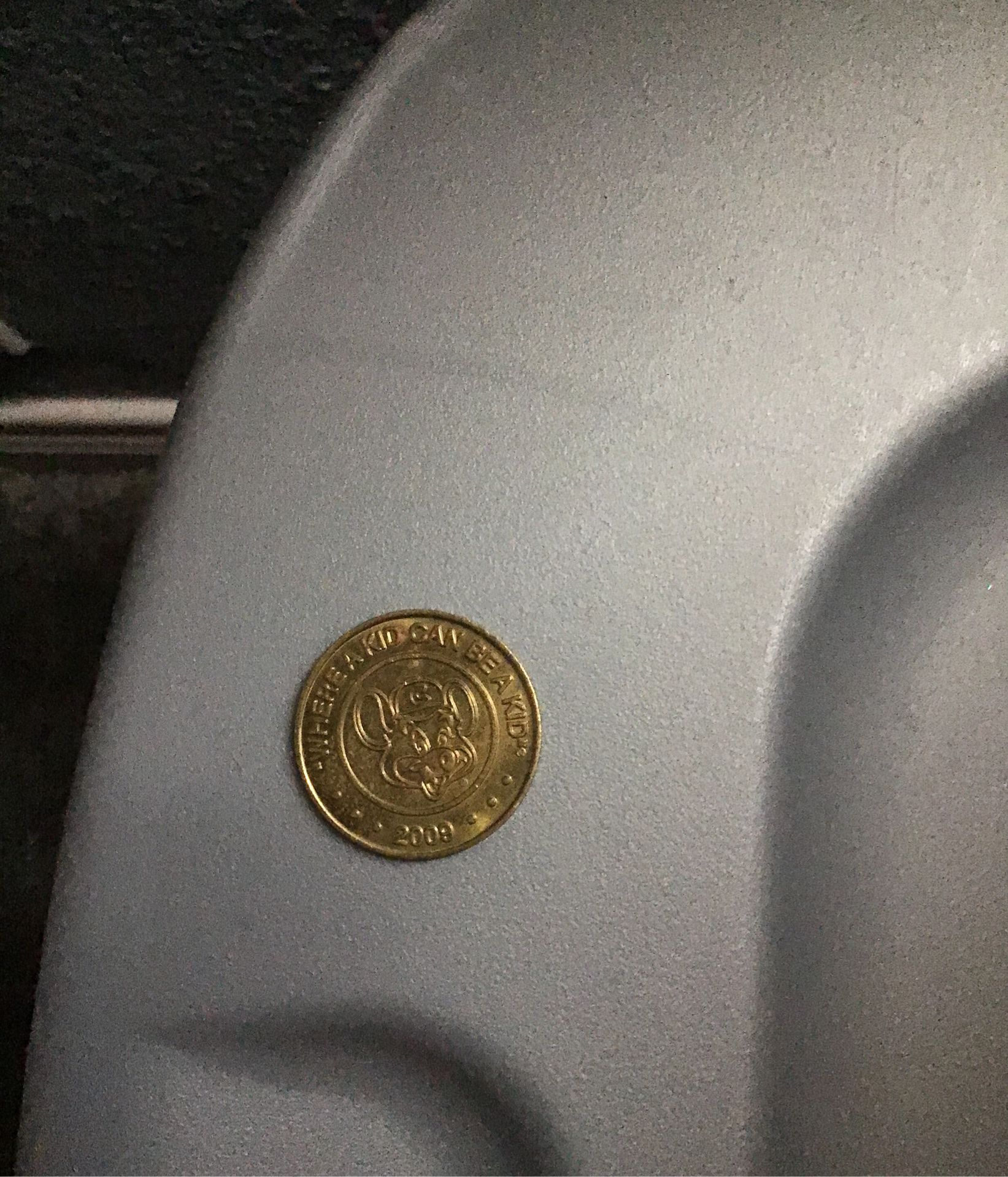 Chuck E. Cheese coin from 2009 they do not make these anymore