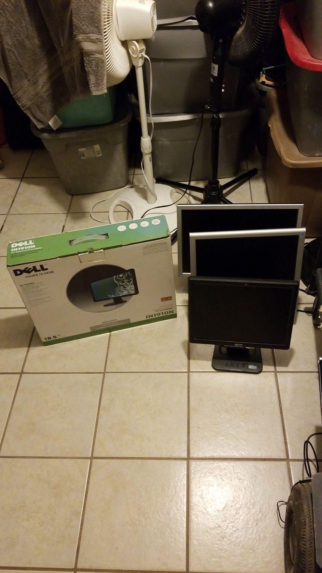 4 computer monitors.