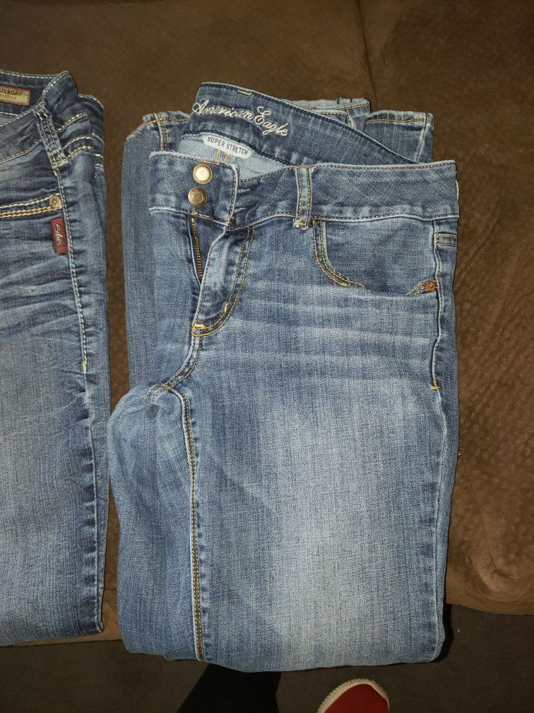 Photo Two pair silver Jeans size 3031 and 3133 and one pair American Eagle size 12 short cut