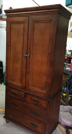 Armoire with an antique Cherry finish for Sale in Chesterfield, VA