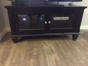 Black wood tv stand / entertainment center for Sale in San Diego, CA
