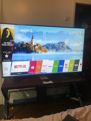 65 in 4K smart tv with stand for Sale in Washington, DC