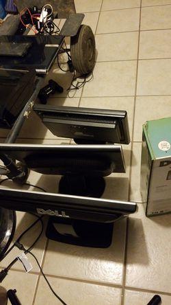 4 computer monitors. Thumbnail
