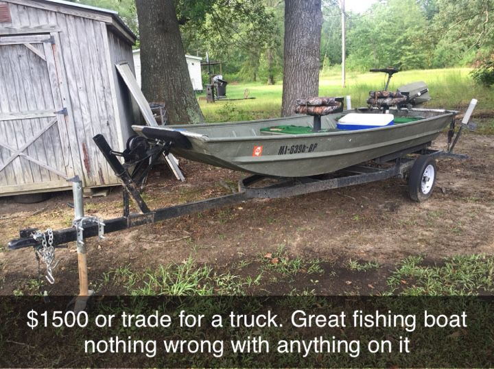 Photo 14 ft aluminum Jon boat with trolling motor and 9.9hp Johnson outboard motor.