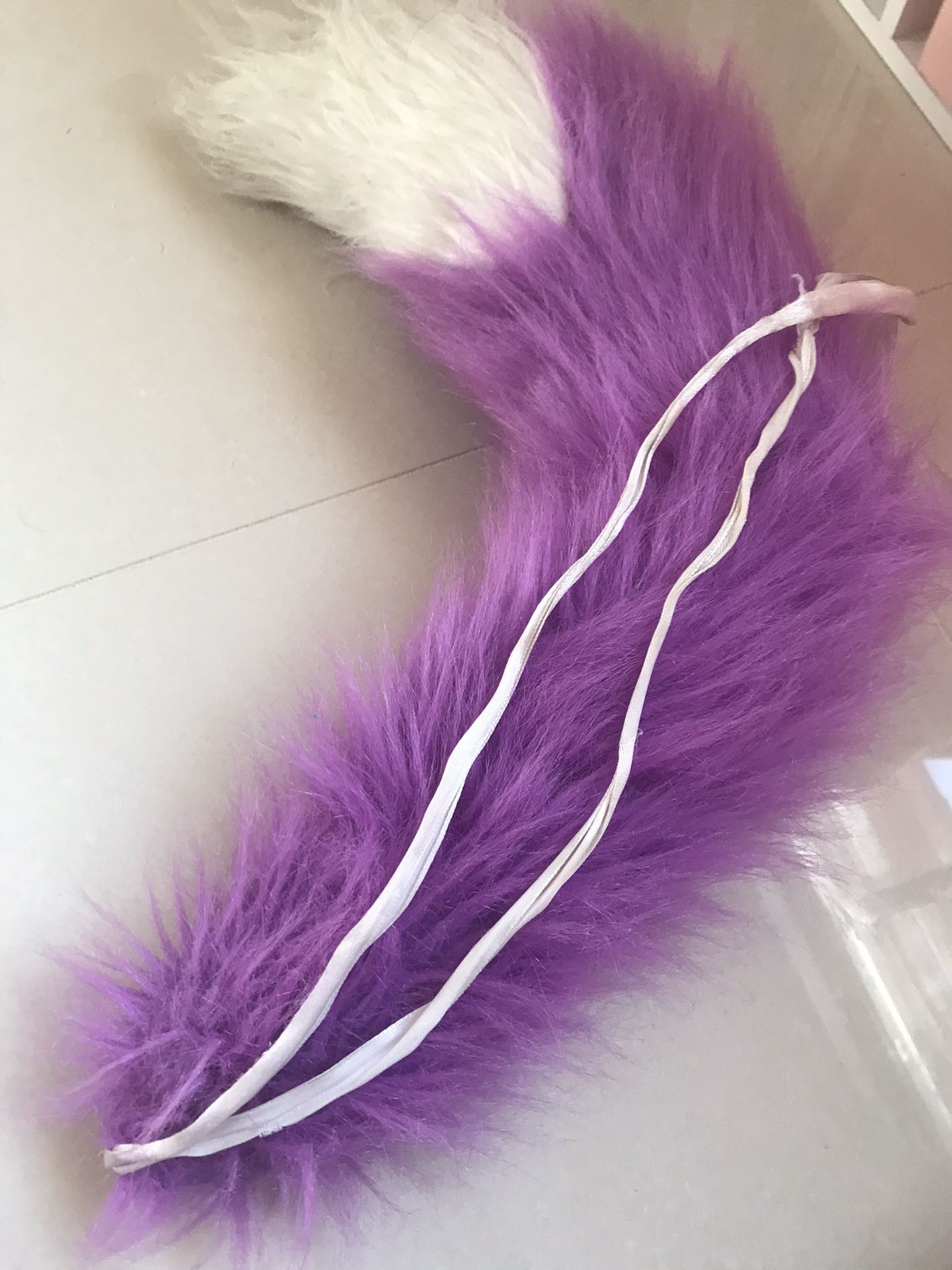 Purple furry tail strap