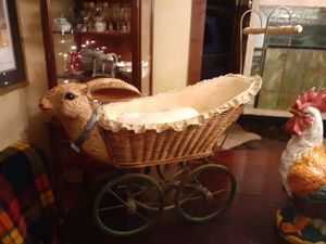 Photo Antique baby carriage with Rabbit