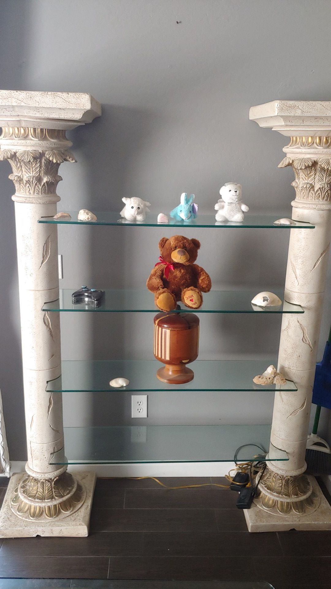 Glass table and chairs and glass shelves