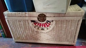 Photo Long and deep White wicker Chest with brass handles shells on the front