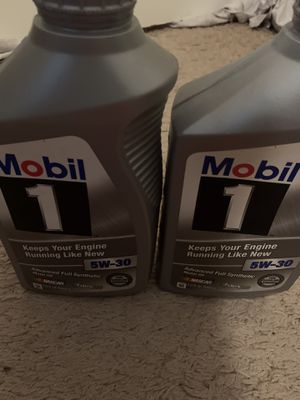 Photo Mobile 1 Advanced Full Synthetic Motor Oil, two bottles of 1 Qt