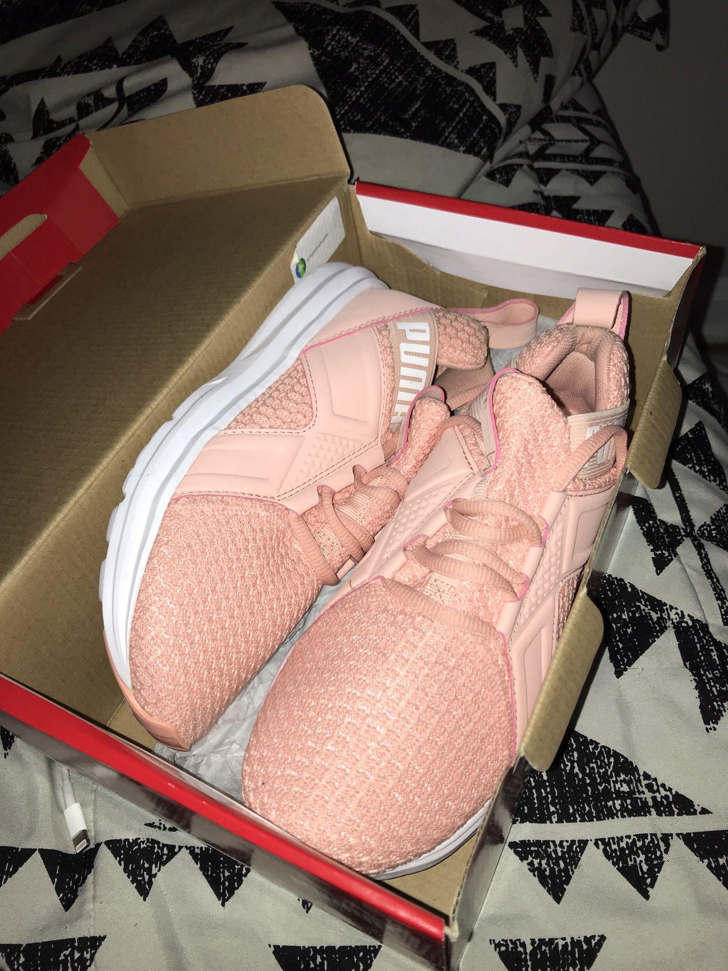 Women's Pink Pumas Size 6