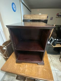Cherrywood cabinet (real Wood) And with shelves on each end and middle. Check out my other items on my profile page Thumbnail
