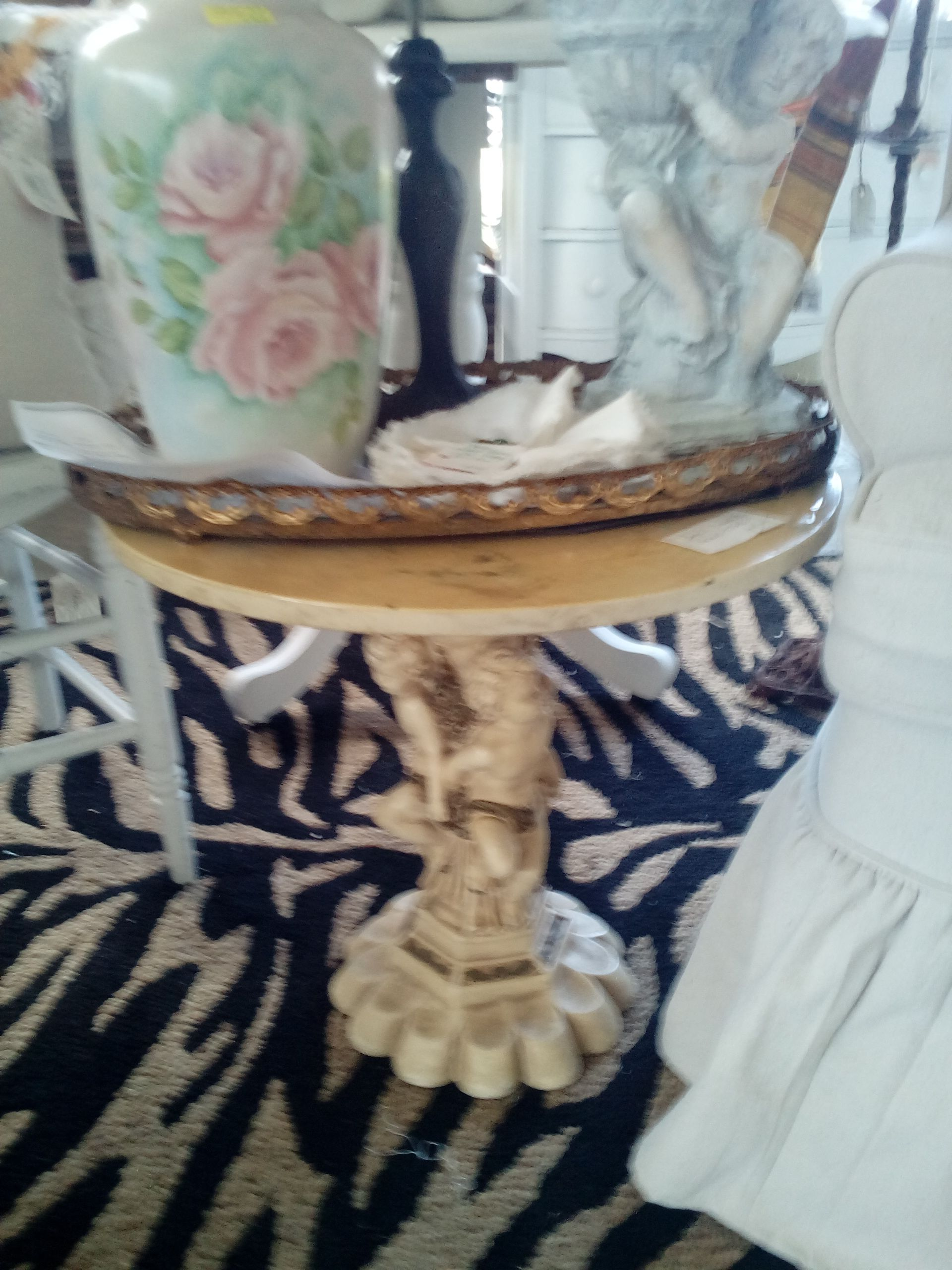 Marble top figural base occasional table