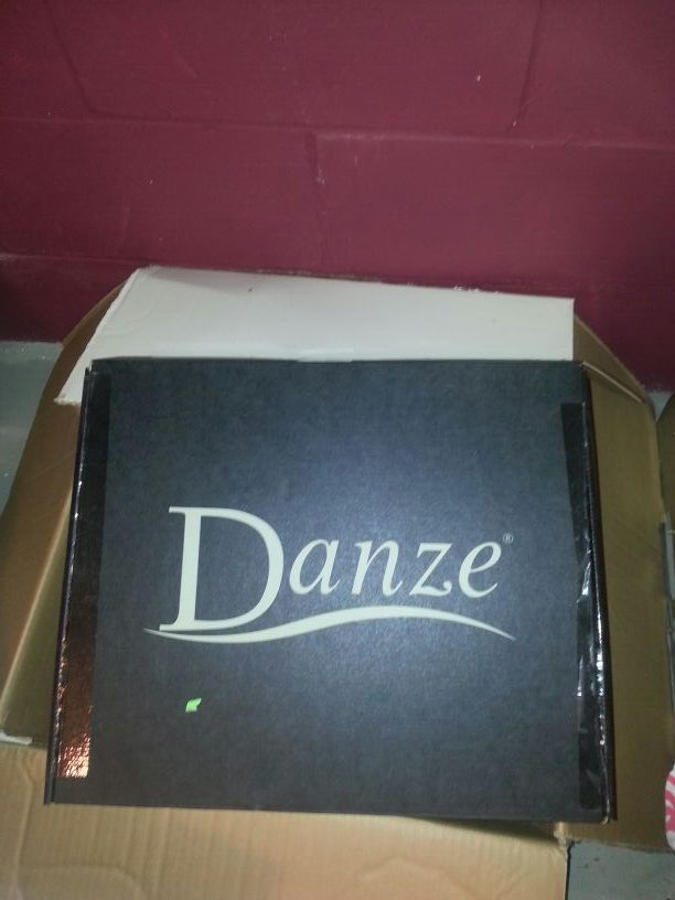 Stainless kitchen faucet. .new in the box
