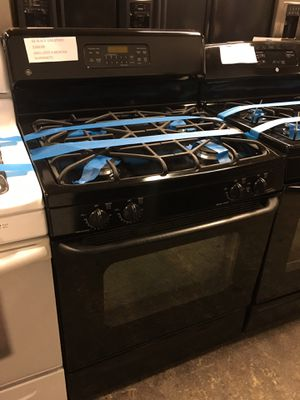 Photo GE BLACK GAS STOVE IN EXCELLENT CONDITION 4 MONTHS WARRANTY
