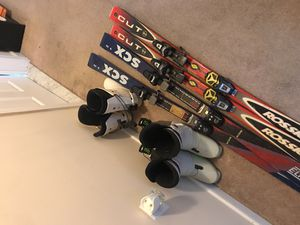 Skis and boots fit sizes 9-11 mens for Sale in Washington, DC