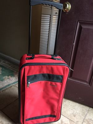 Red carryon suitcase with wheels for Sale in North Potomac, MD