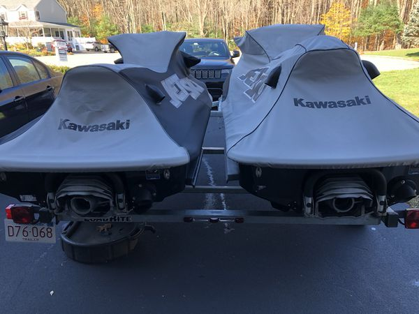 (2) 2017 kawasaki jetskis w/trailer, covers and in water docks