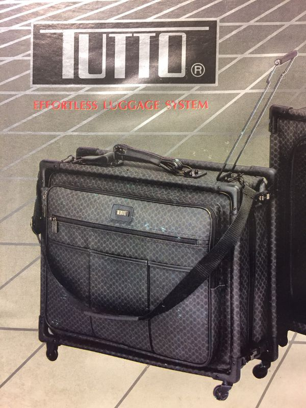 8a91b7fc32 Wheeled Garment Bag! TUTTO Collapsible Carry-On Luggage with 4-Wheel drive.  TUTTO has been recommended by back specialists and physiotherapists