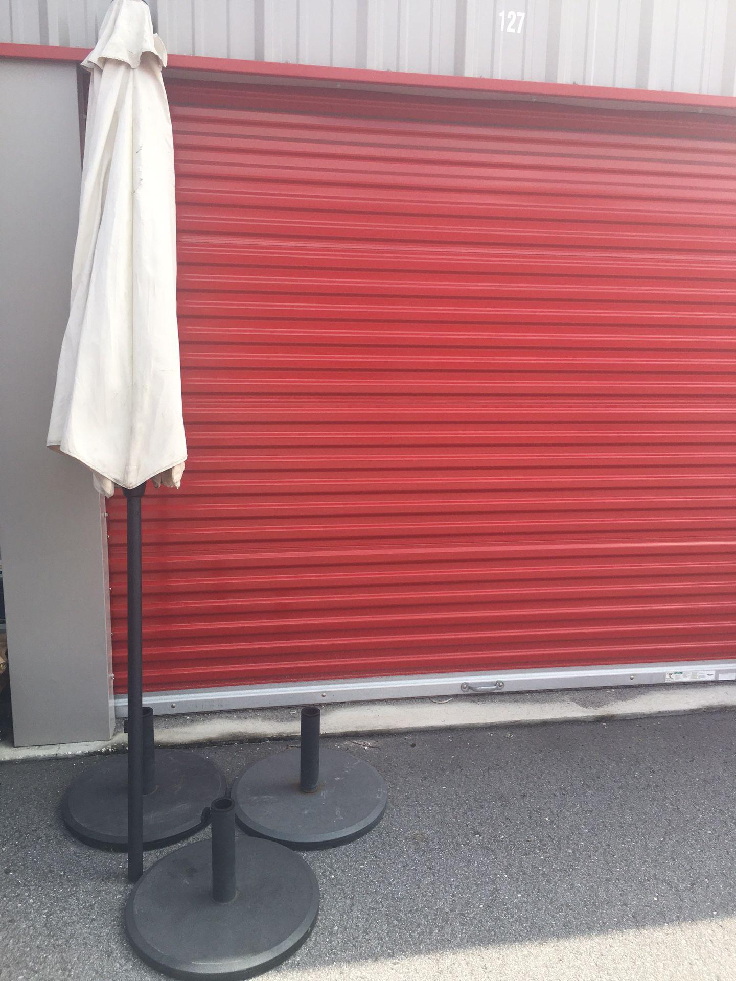 3 Heavy Patio Umbrella Base- 3 Used Umbrellas