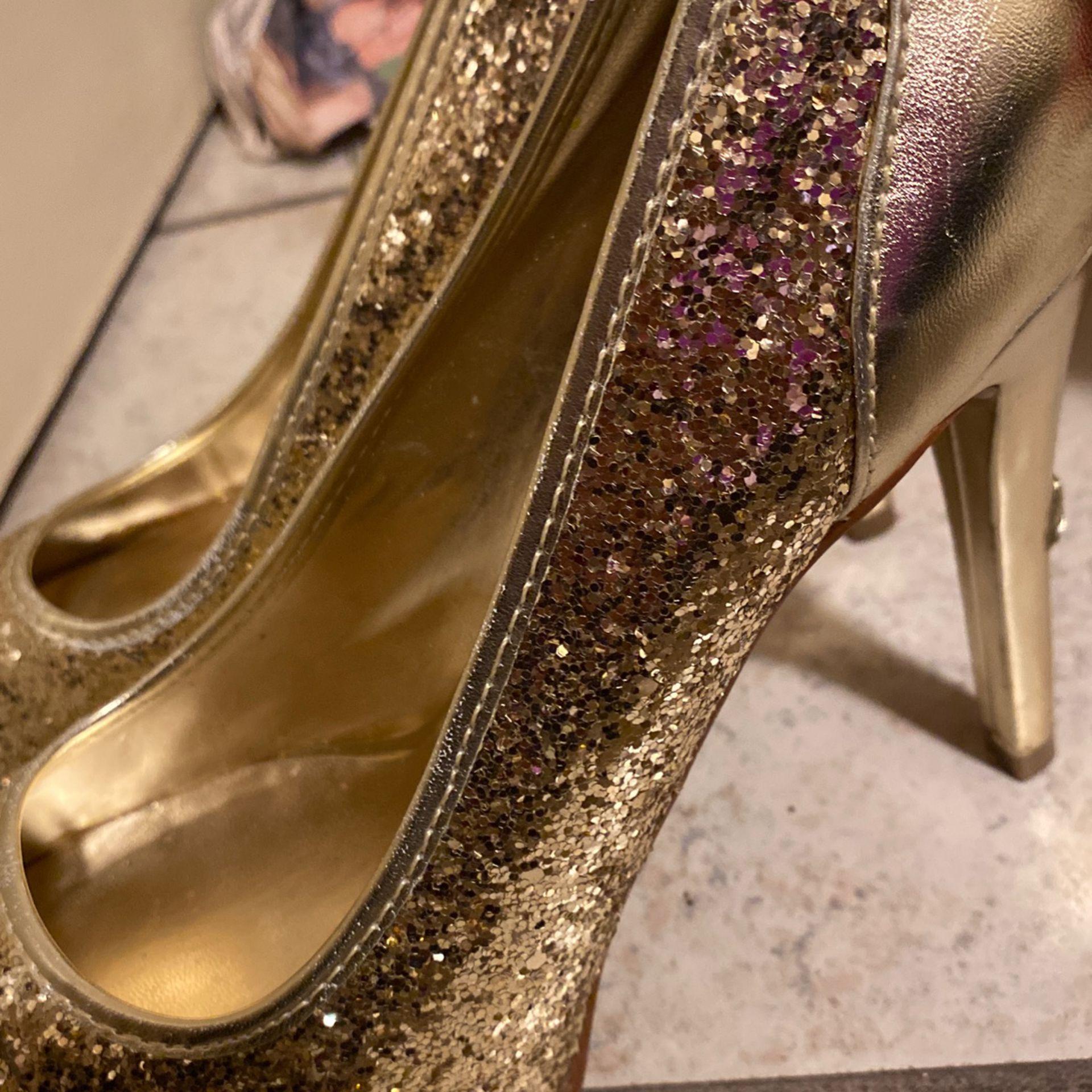 Super cute GUESS gold high heels