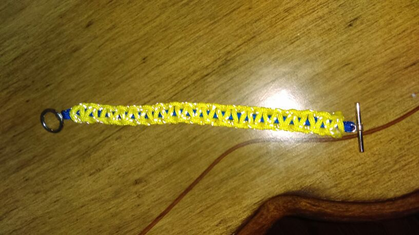 Yellow and blue survival paracord bracelet with metal clasp
