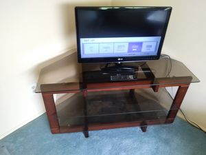Samsung flat screen TV with remote OR 3 tier black tint TV stand for sale for Sale in St. Louis, MO