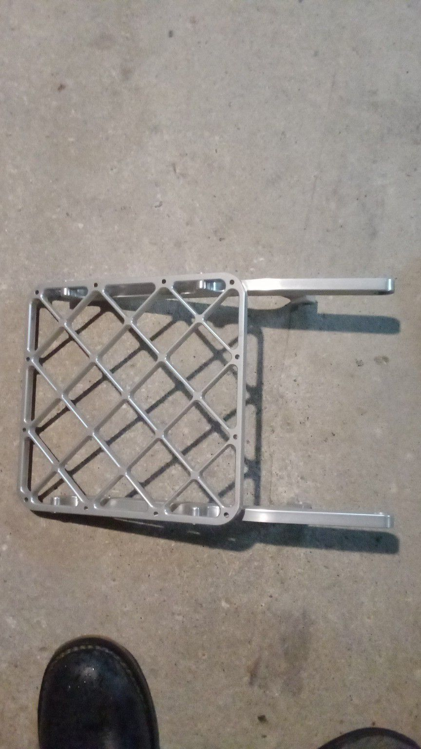 Photo Brand new never used universal Luggage rack for dual sport dirt bikes got it for drz400e an never put it on the bike they are 130$ new Ill take 60$