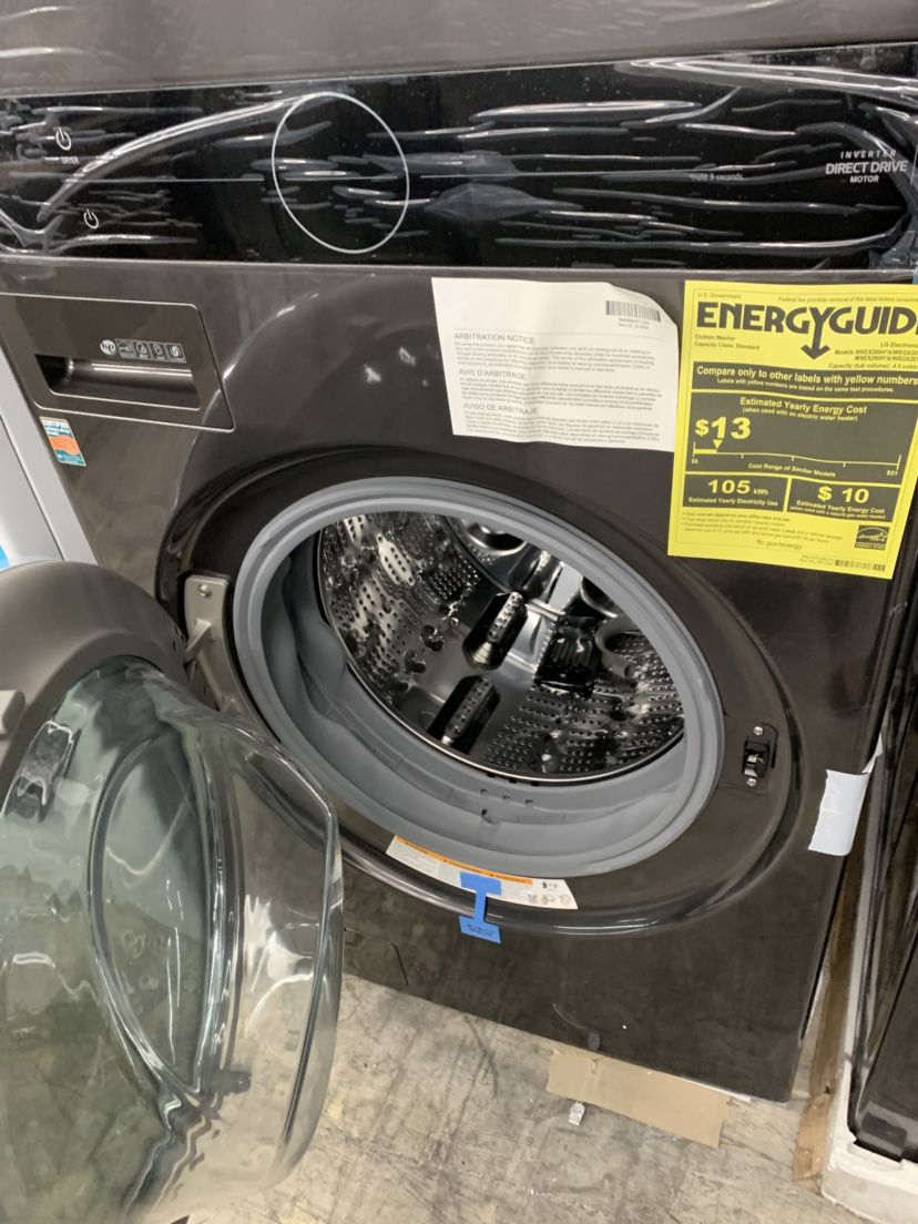 New LG Black Stainless Steel Stacked Washer And Dryer Gas With Steam