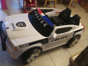 Photo Police car working very well charger battery lg car two seater