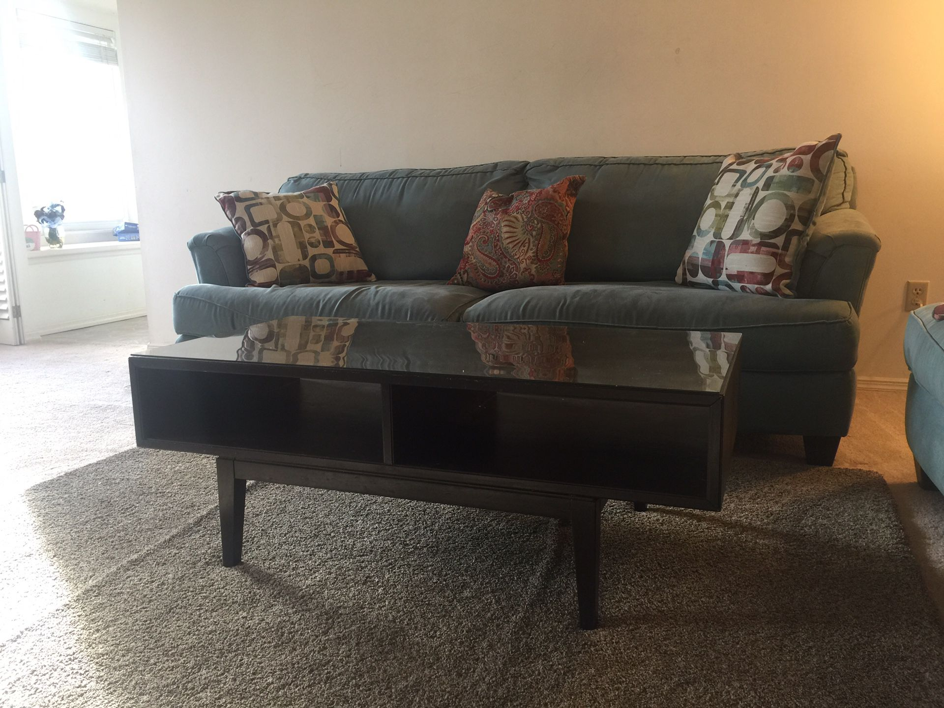 Two sofa, a coffee table, and blue rug.