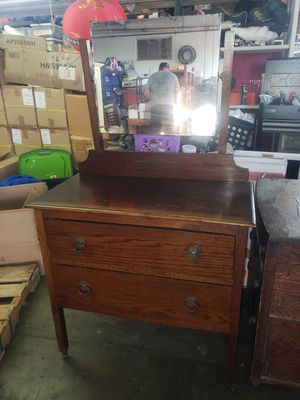 Photo Antique old solid wood dresser with mirror