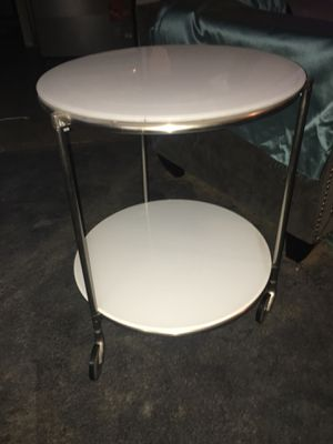 2 tier round white glass table on wheels for Sale in Los Angeles, CA