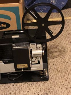 8 mm Argus Showmaster movie projector and screen. Thumbnail