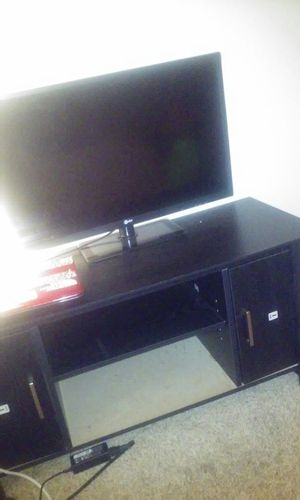 Tv with stand for Sale in Richmond, VA