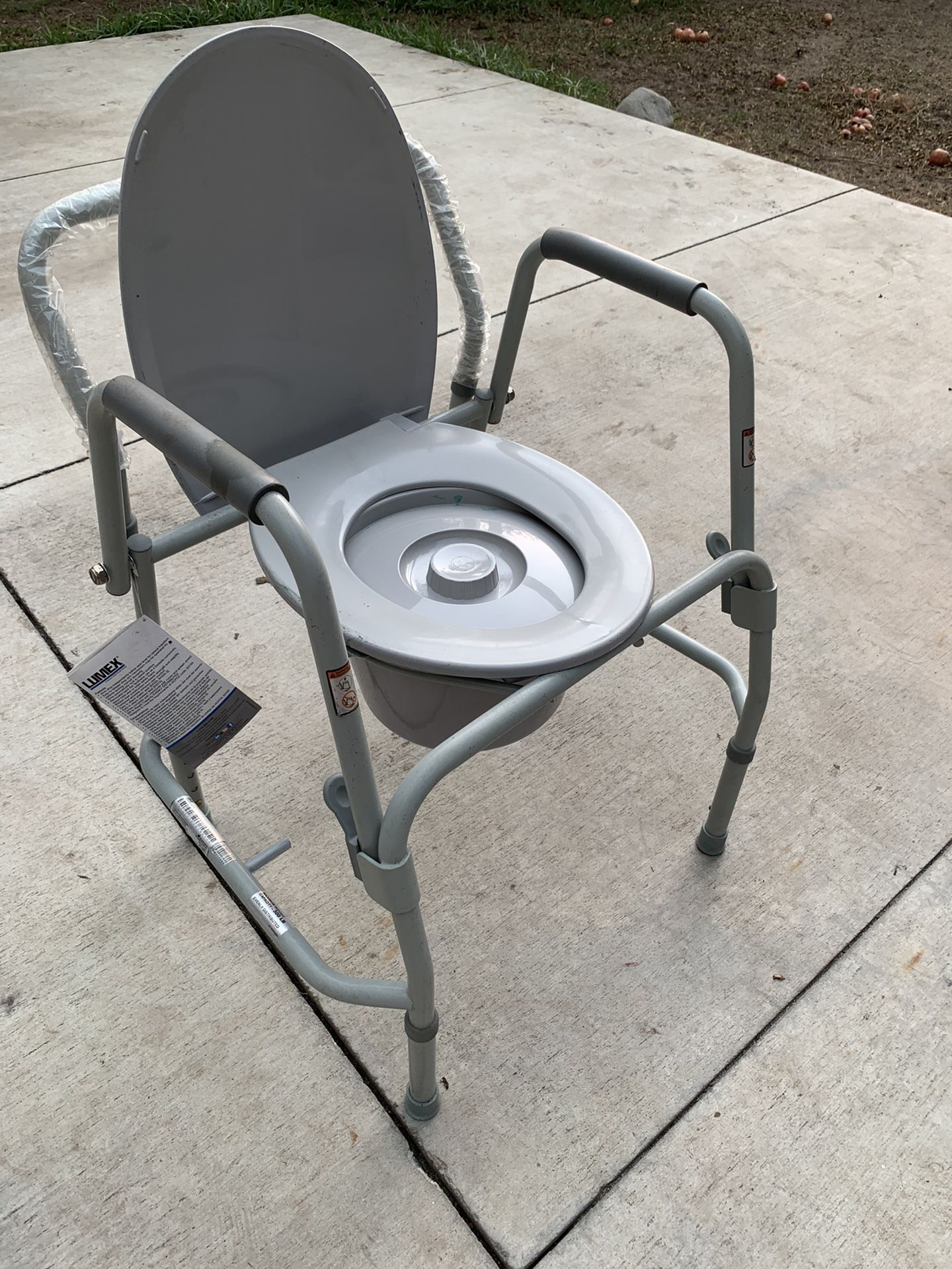 Bed side toilet seat for handicap or disabled person