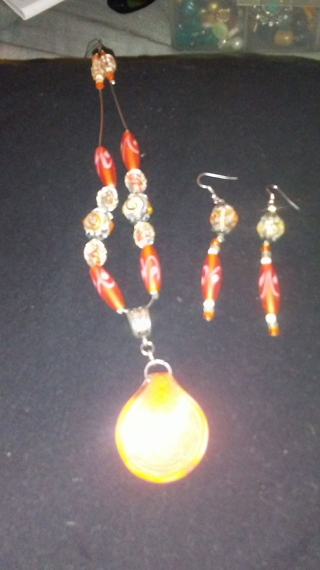 Handcrafted orange glass necklace and earring set