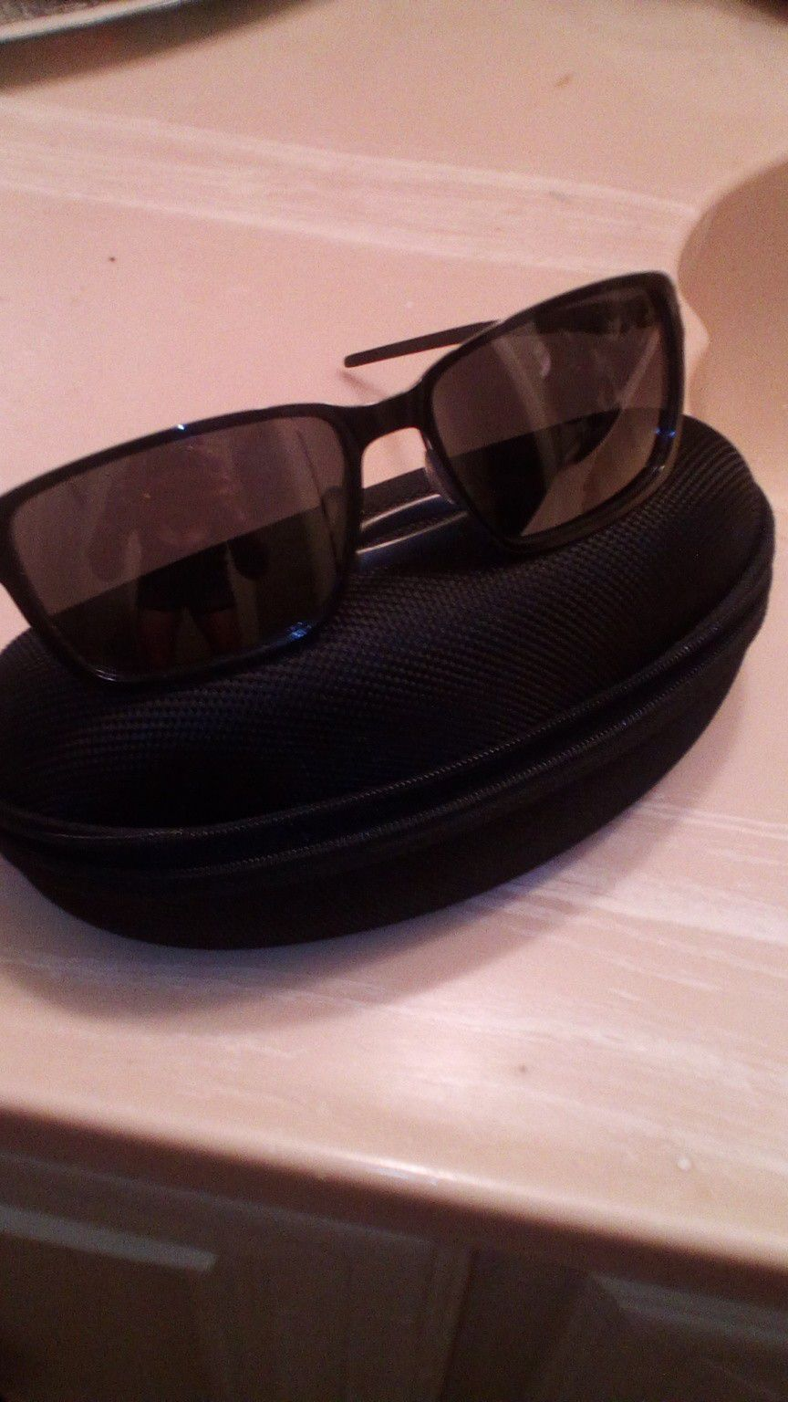 Oakley men's glasses brand new with a case