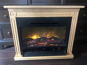 Photo Heat surge electric fireplace