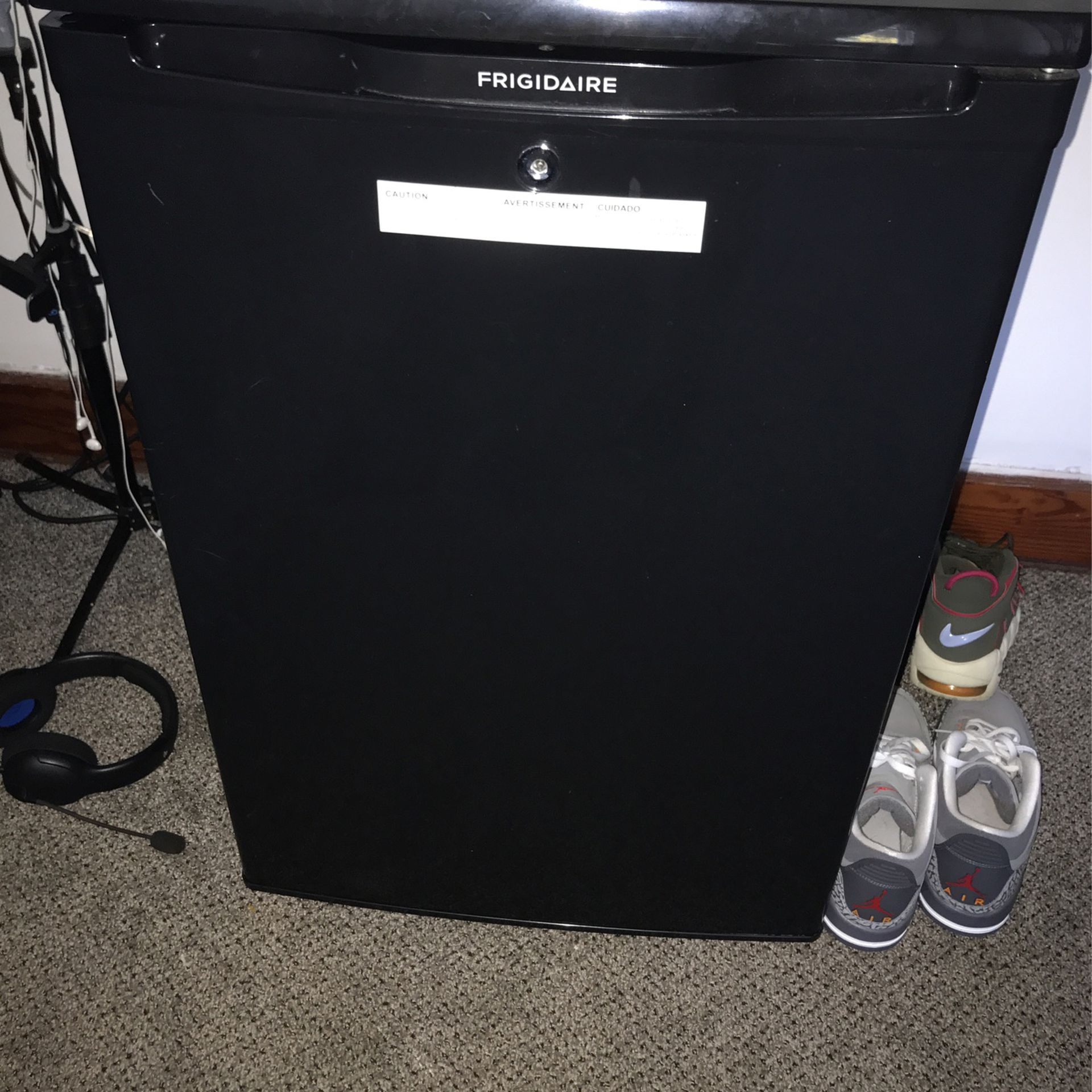Frigidaire mini refrigerator, nothing wrong with it works perfectly fine! will be cleaned out for whoever buys it! needs gone ASAP!