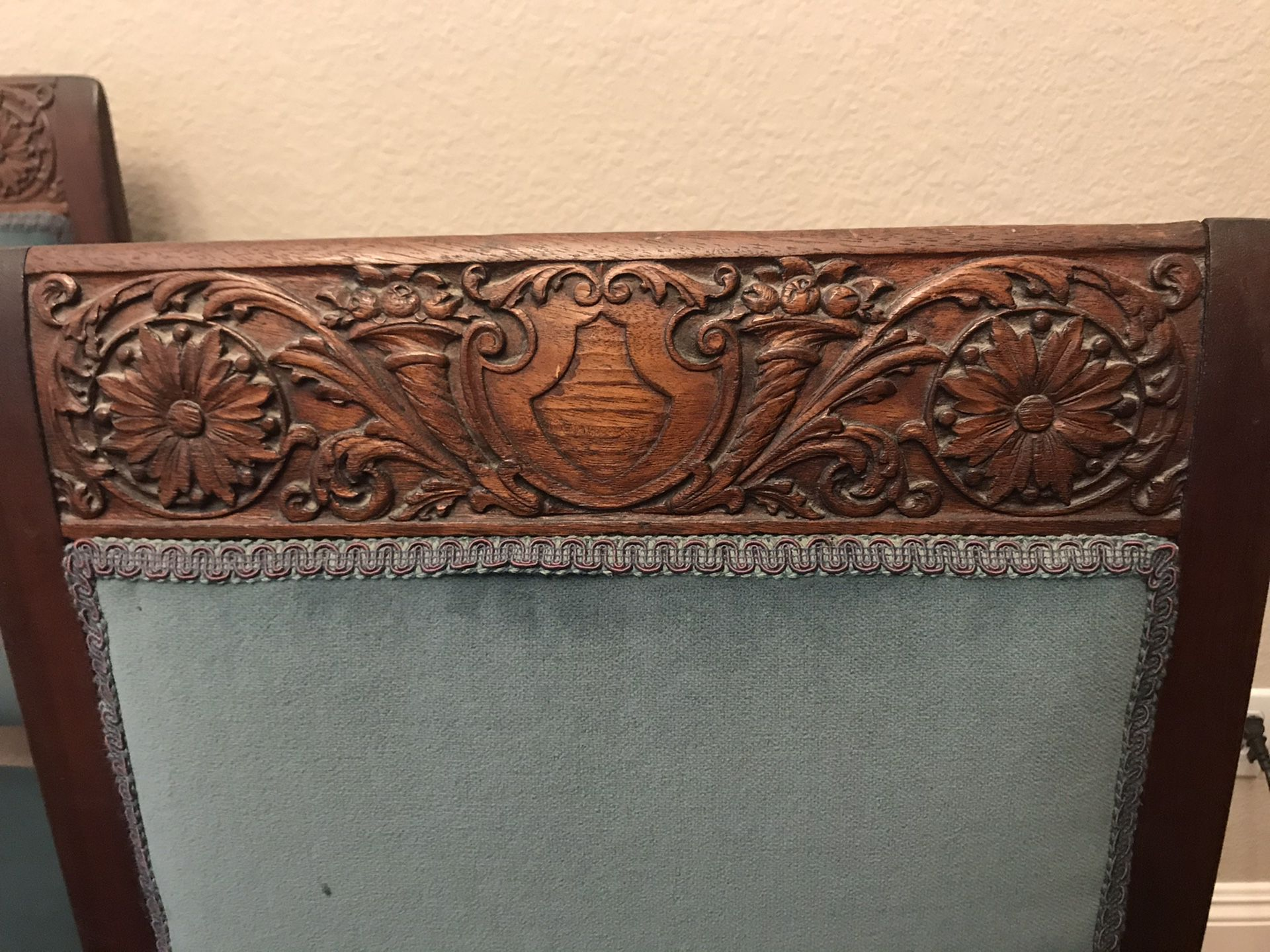 Antique dining table and 6 chairs. Slight repair needed on one chairs upholstery coming loose from frame.