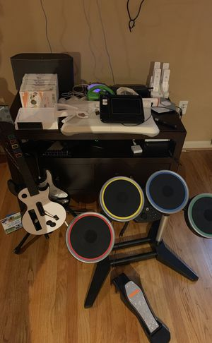 Nintendo WII - lots of games - Rock Band, WII Fit, shooting attachment, Mario Cart - 4 controllers - it all works for Sale in Alexandria, VA