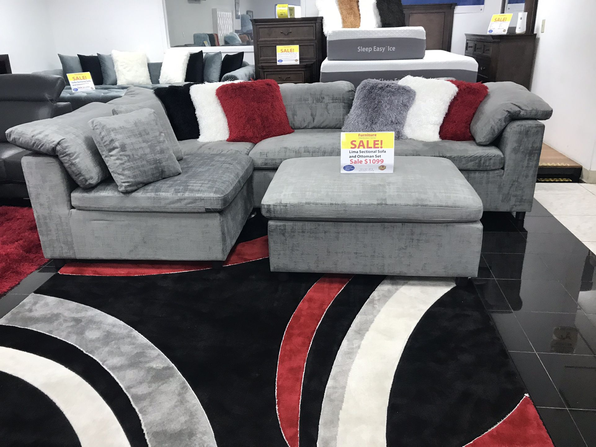 BEAUTIFUL GRAY MODULAR AND OTTOMAN. SAME DAY DELIVERY AND EASY FINANCING .
