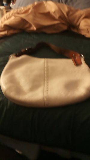 Photo Cream color Coach purse with brown leather straps