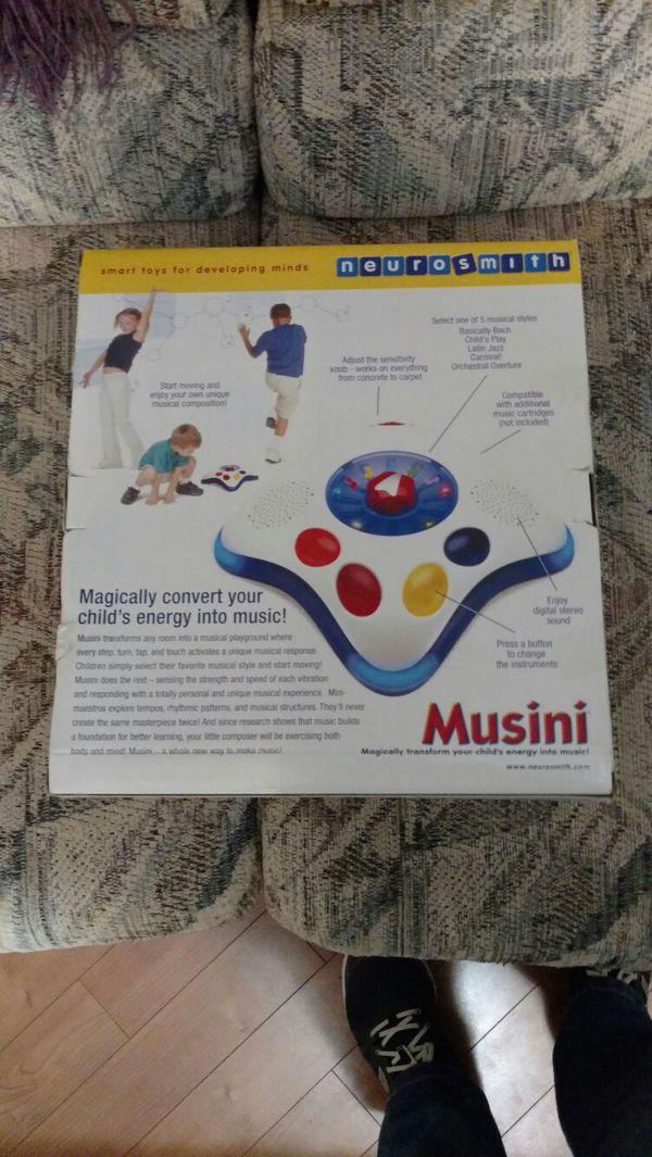 Musini musical motion toy w/ magic wand nib plus x extra.