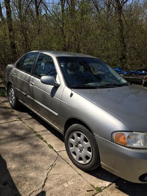 Photo 2002 Nissan Sentra 4 door only has 113,000 miles. Clean on the inside automatic good tires. Has a prior salvage title but only replaced the fender